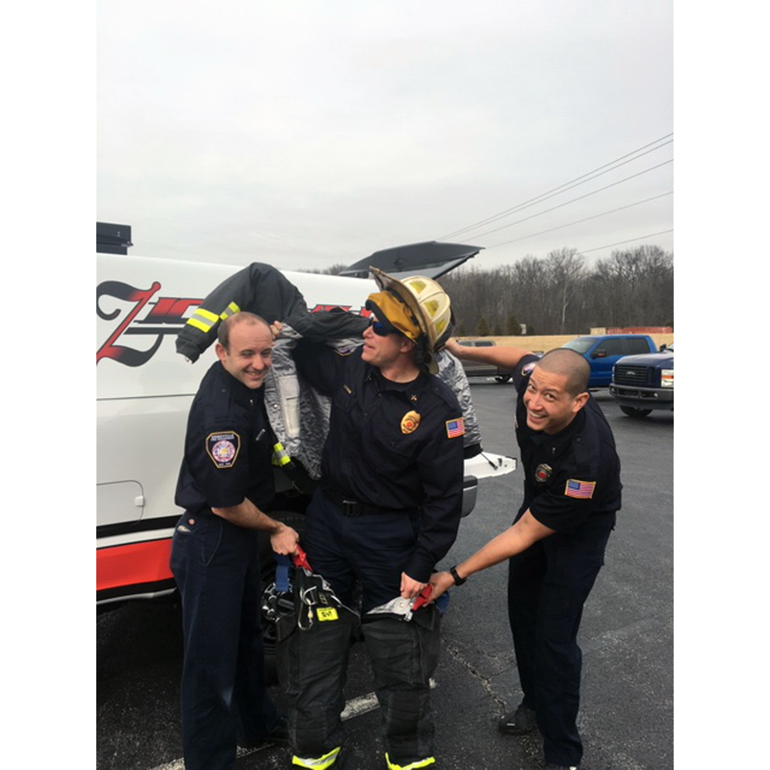 3 Zionsville firefighters posing